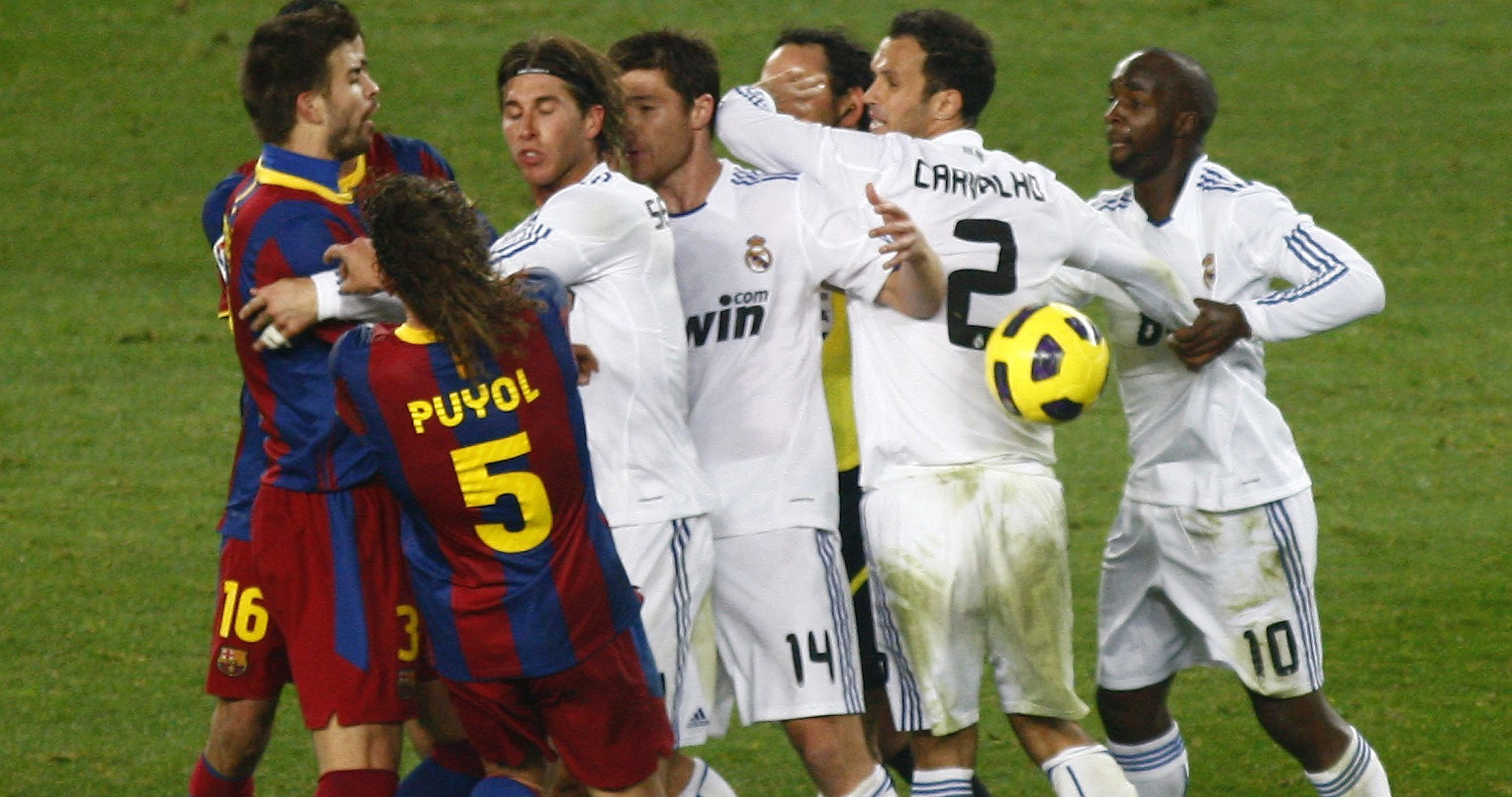 Real Madrid's Ramos pushes Barcelona's Puyol during their Spanish first division soccer match in Barcelona