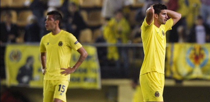 Villarreal's Catala and Mussachio react after their Champions League soccer match against Manchester City in Villarreal