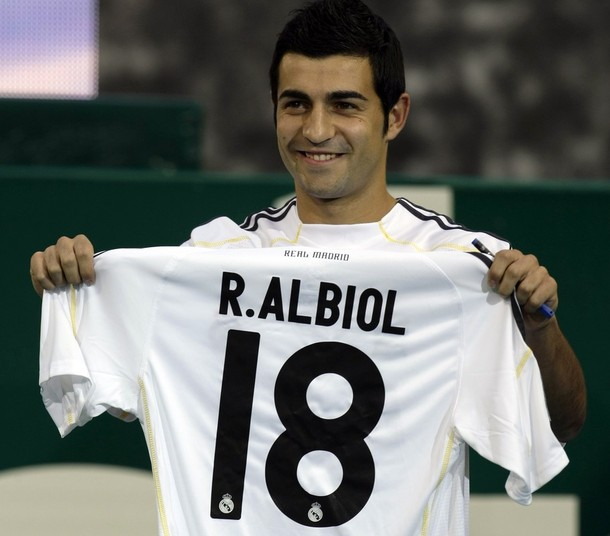 Real Madrid's new soccer player Raul Albiol of Spain holds his shirt during his presentation ceremony in Madrid