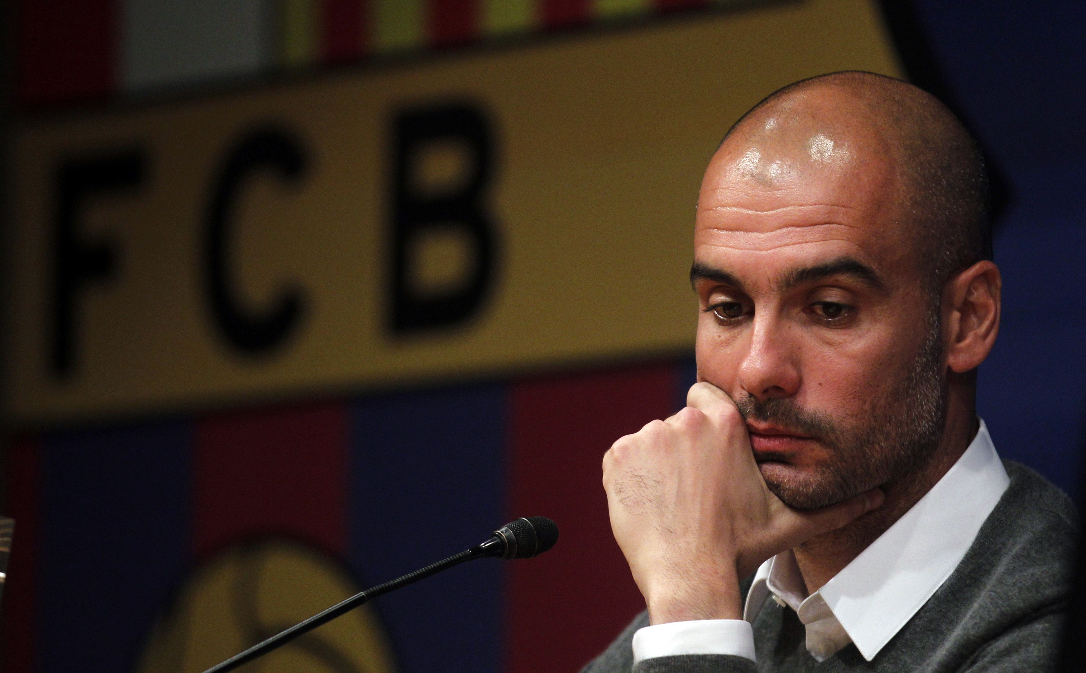Barcelona's coach Guardiola ponders during a news conference at Camp Nou stadium in Barcelona