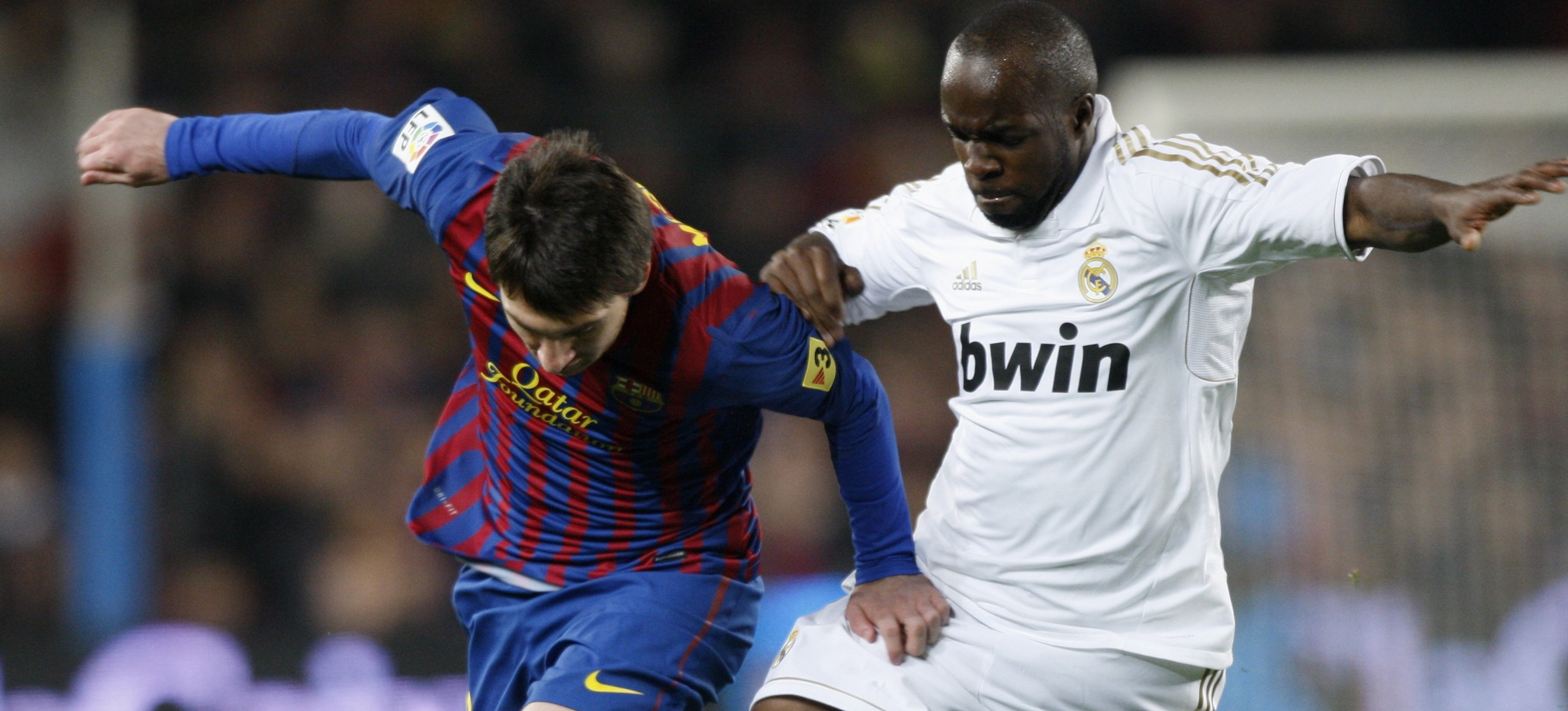 Barcelona's Messi is challenged by Real Madrid's Diarra during their Spanish King's Cup quarter-final soccer match in Barcelona